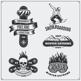 Set of Snowboarding extreme labels, emblems, badges and design elements. Vintage mountain adventure symbols. Royalty Free Stock Photography