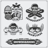 Set of Snowboarding extreme labels, emblems, badges and design elements. Vintage mountain adventure symbols. Stock Photography