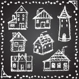 Set of snowbound chalk painted houses with Royalty Free Stock Photo