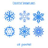 Set of snowflake hand drawn with oil pastels Stock Image