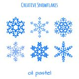 Set of snowflake hand drawn with oil pastels Royalty Free Stock Images
