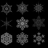 Set of snowflake icon graphic sign symbol drawing. Collection of white snowflake isolated on black background. High resolution Royalty Free Stock Photos