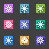 Set of snowflake icons on multi-colored square backgrounds for applications and the Internet. Vector on a gray background. royalty free illustration