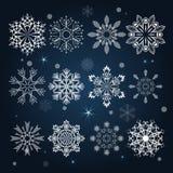 Set of snowflake shapes. On dark blue background Royalty Free Stock Photography
