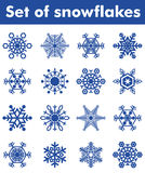 Set of snowflakes. Set of blue snowflakes of different shapes on a white background Royalty Free Stock Image