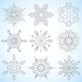 Set of snowflakes. Contoured mandalas. Snowflakes for adult coloring book or art therapy.  Stock Image