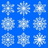 Set of snowflakes of different shapes. Patterned decorative snowflakes. Winter symbolism. Vector Image. Royalty Free Stock Images