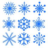 Set of snowflakes of different shapes. Patterned decorative snowflakes. Winter symbolism. Vector Image. Royalty Free Stock Photo