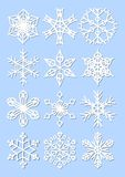 Set of snowflakes, monoline design with fine shadow. Winter design elements on light blue background. Stock Photo