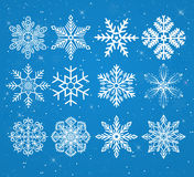 Set of snowflakes on a snowy background with stars Royalty Free Stock Photography