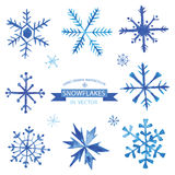 Set of Snowflakes in Watercolor. Set of Snowflakes - hand drawn in Watercolor - vector Stock Photos