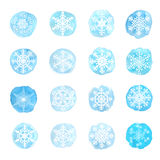Set of snowflakes on watercolor spots Royalty Free Stock Photos