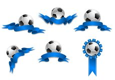 Set of soccer balls with blue ribbons Stock Images