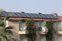 A set of solar panels on the roof Stock Images