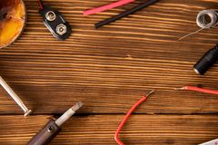 Set for soldering wire and shrink soldering tube with solder on a wooden background royalty free stock photo