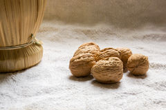 Set with some walnuts. And a wine bottle Royalty Free Stock Photography