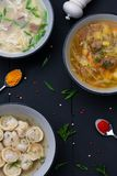 Set soups on black wooden background. Top view stock photo