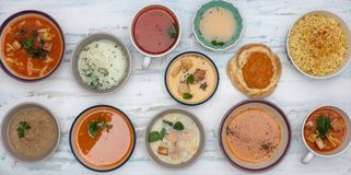 Set of soups from worldwide cuisines. Fresh and healty soups on painted background, Top view stock image