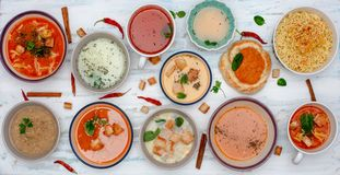 Set of soups from worldwide cuisines. Fresh and healty soups on painted background, Top view royalty free stock photos