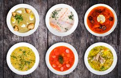 Set of soups. Cream soup with mushrooms, asian fish soup, solyan. Set of soups from worldwide cuisines, healthy food. Cream soup with mushrooms, asian fish soup Royalty Free Stock Images