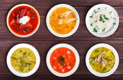 Set of soups from worldwide cuisines, healthy food. Cream soup with mushrooms, asian fish soup, soup with meat - solyanka, russian borscht, chicken soup on royalty free stock image