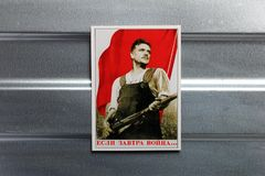 Photo Soviet propaganda poster life style. Set of soviet posters, military, life style, on metal wall Stock Image