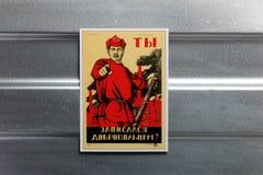 Photo Soviet propaganda poster life style. Set of soviet posters, military, life style, on metal wall Royalty Free Stock Photo
