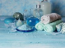 Set for spa with towels, salt and aromatic oils, selective focus Stock Images