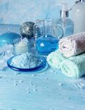 Set for spa with towels, salt and aromatic oils, selective focus Royalty Free Stock Photos