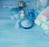 Set for spa with towels, salt and aromatic oils, selective focus Royalty Free Stock Image
