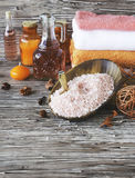 Set for spa with towels, salt and aromatic oils, selective focus Royalty Free Stock Photography