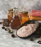 Set for spa with towels, salt and aromatic oils, selective focus Royalty Free Stock Photo