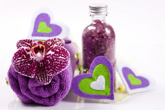 Set for spa treatments. Orchid, candle and towel. Stock Images