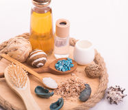 Set for spa. Wooden board with a spoon, bath salt, body oil, de stock photography