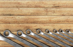 Set of spanners as background 3d render on wood Stock Photo