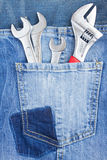 Set of spanners in jeans pocket Royalty Free Stock Images
