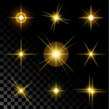 Set of sparkling gold stars. Set of the realistic sparkling gold star fires and flashes on a transparent background a  illustration Royalty Free Stock Photo