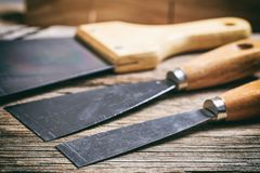 Set of spatulas on wooden background Royalty Free Stock Images