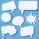 Set of speech bubbles without phrases on blue background. Stock Photography