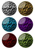 Set of spheres with swirly pattern decoration in different color variants Royalty Free Stock Photos