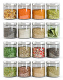 Set of spices in glass bottles. On white background stock illustration