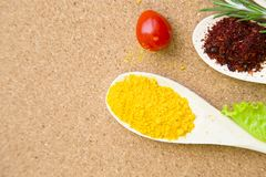 Set of spices and herbs on a corkwood stock image