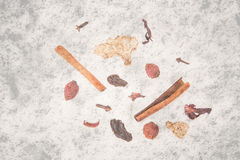 Set spices for mulled wine on old textured Stock Image