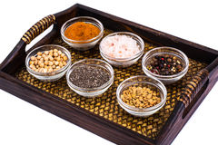 Set of spices and seeds of legumes in glass molds on tray Stock Photography