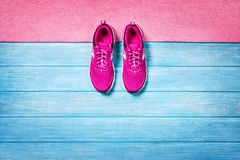 Set for sports activities on blue wooden background, top view. Fitness shoes over blue planks background. Sport shoes and accessories for sports activities on royalty free stock image