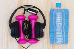 Set of sports pink. Objects and sports towel on the table Royalty Free Stock Image
