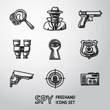 Set of Spy handdrawn icons - fingerprint, spy, gun. And binocular, eye in keyhole, badge, surveillance camera, rear sight, dictaphone. Vector illustration Royalty Free Stock Images