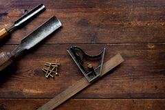 Set square and chisels, flat lay, overhead Royalty Free Stock Photo