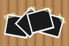 Set of square frames on sticky tape with shadows on brown wooden texture Royalty Free Stock Images