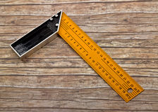 Set-square isolated on old wood Stock Images
